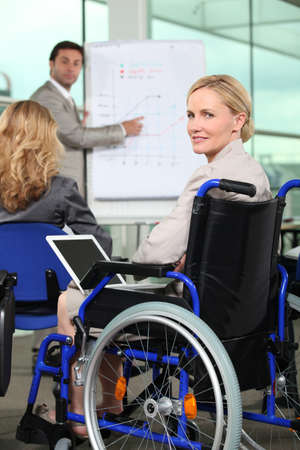 Bussinesswoman in wheelchair photo
