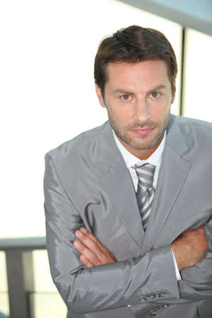 Businessman with arms crossed. photo