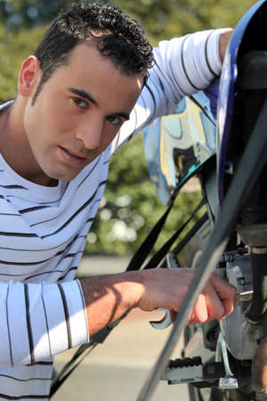 Man repairing motorcycle photo