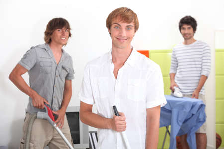 doing chores: Three lads doing their chores Stock Photo