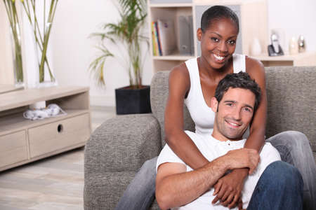 happy mixed couple at home Stock Photo - 11319131