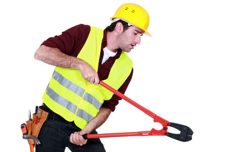 Tradesman using a pair of clippers Stock Photo - 11306739