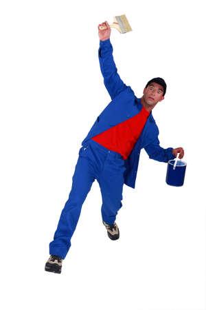 panicked: Shocked painter falling backwards Stock Photo