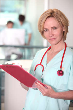 Blond nurse at work. photo