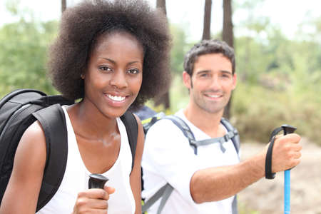 trekking pole: Couple out on a hike together Stock Photo