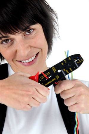 Woman with a wire stripper photo