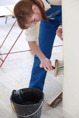 Woman wallpapering photo