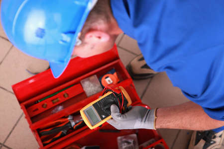 multimeter: Man with electricity measurer