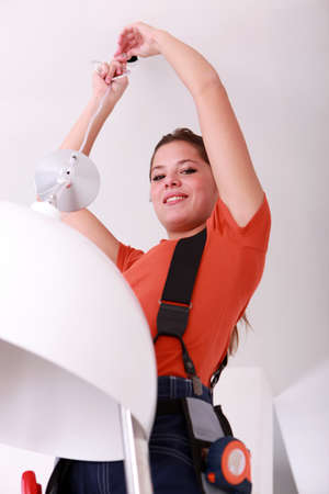 portrait of a woman doing electricity work photo