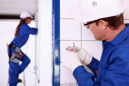 wall socket: Electrician installing a wall socket Stock Photo