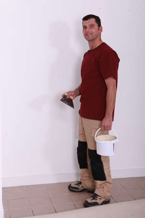 handyman with a glue pot and a float Stock Photo - 11382527