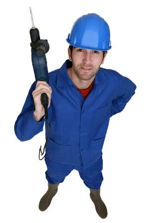 Tradesman holding up an electric screwdriver photo