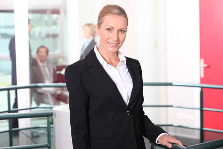 Mature businesswoman standing in agency photo
