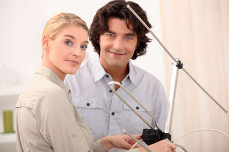 telly: Couple with a television antenna