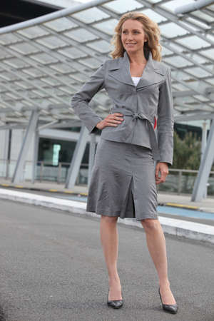 40 50: Businesswoman standing with hand on hip