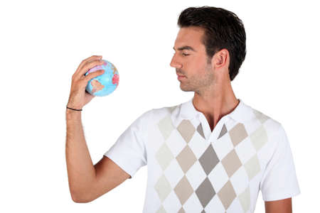 Young man holding a globe Stock Photo - 11382698