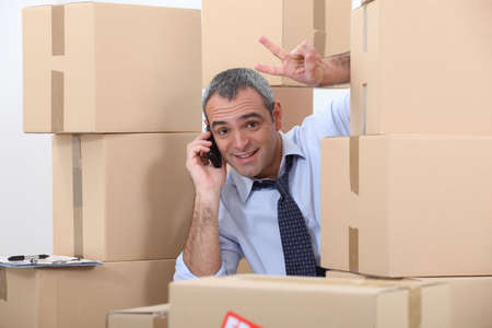 relocate: Man surrounded by cardboard boxes