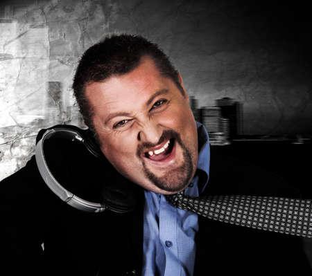 disc jockey: Crazy man in suit with headphones Stock Photo
