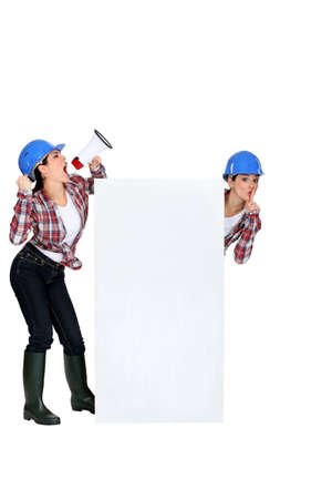 tight jeans: twin sisters with hard hat and loudspeaker