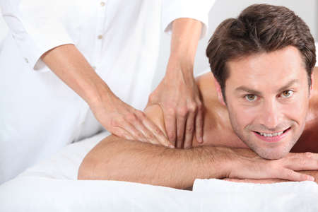 Man being given a massage. photo
