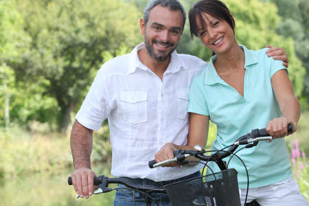 well being: Couple riding bikes