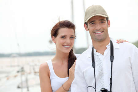 Nice couple walking down the marina. photo