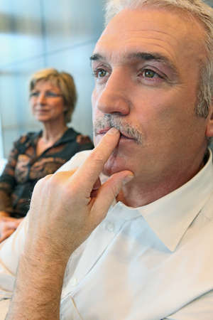intensely: Man watching something thoughtfully