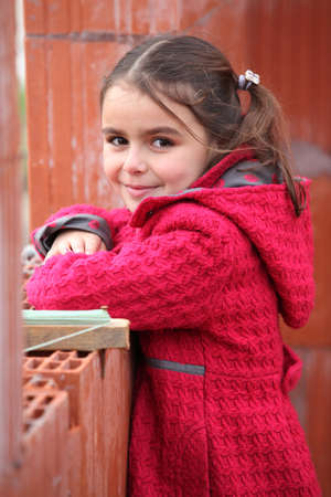 Cute little girl wearing a red coat photo