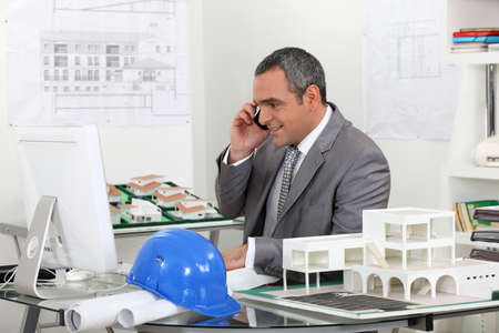 real estate businessman working in his office photo
