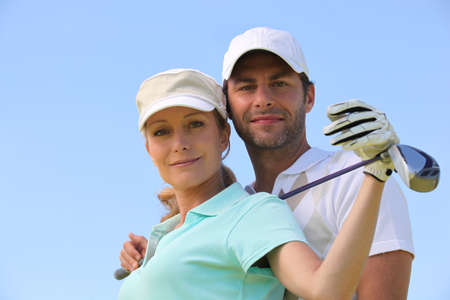 gaiety: Couple playing golf