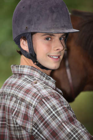 equitation: Portrait of a young horseback rider Stock Photo