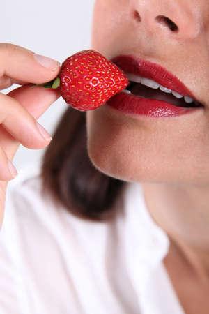 matron: woman eating strawberry