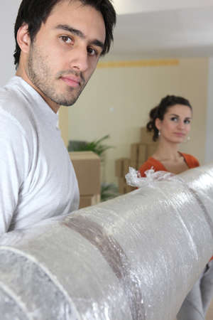 couple moving into a new housing Stock Photo - 11389614