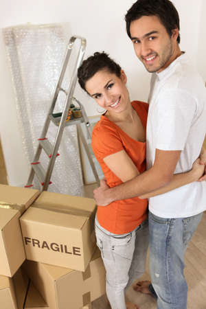 Couple with boxes marked fragile photo