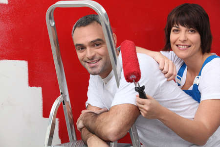 couple repainting their apartment Stock Photo - 11382953