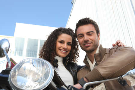 Urban couple on a moped photo