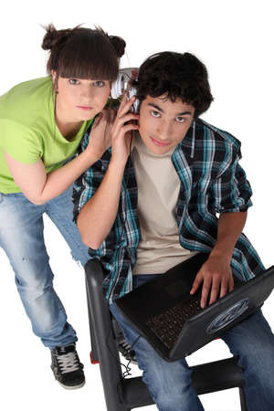 Teenagers sharing headphones photo