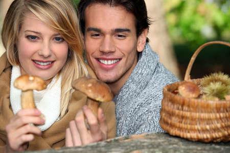 Couple looking at mushrooms photo