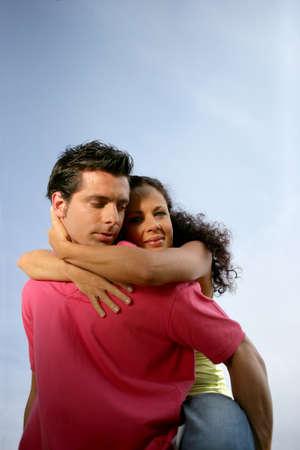 piggy back: Man giving girlfriend piggy-back