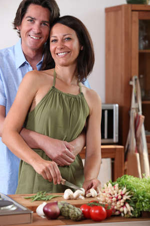 straps: couple in the kitchen Stock Photo