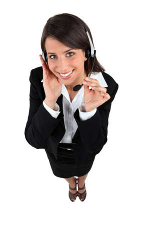 Studio shot of a woman with a headset photo
