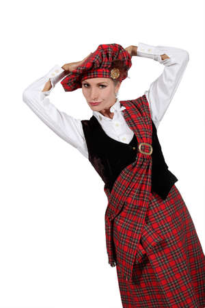 clowning: A young woman wearing a Scottish costume and looking at us.