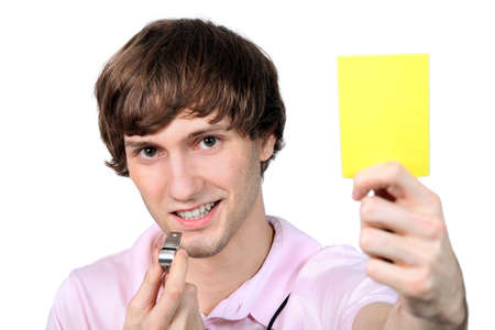 arbiter: Referee showing the yellow card