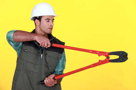 clippers: Tradesman holding large clippers
