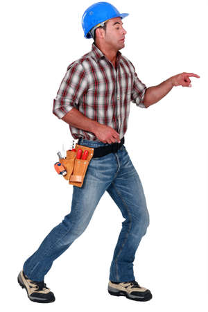 poking: A male construction worker poking something scary. Stock Photo