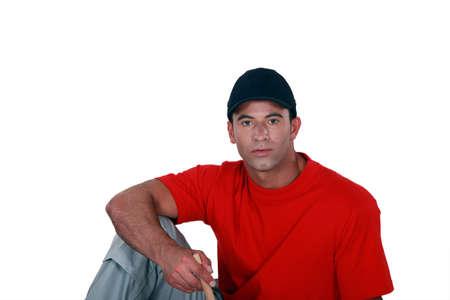 Portrait of a man with cap, studio shot photo