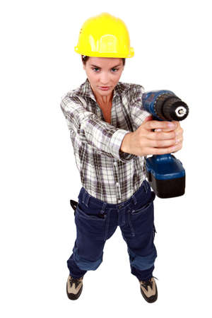 Young woman with a drill photo