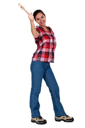 spunky: Woman holding a paintbrush