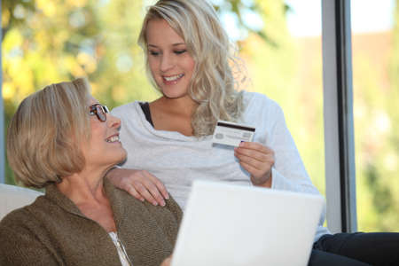 secure payment: Mother and daughter shopping online