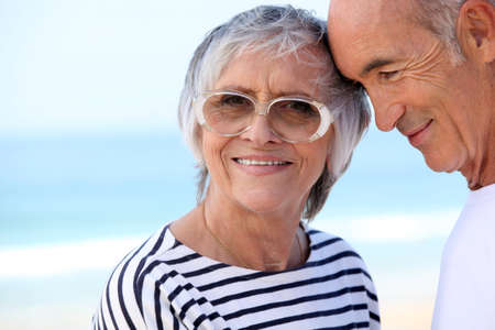 65 70 years: Elderly couple at the beach together Stock Photo